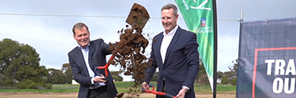University of Adelaide Vice-Chancellor Professor Peter Rathjen and Minister for Energy and Mining Dan van Holst Pellekaan turn the first sod of the new solar farm